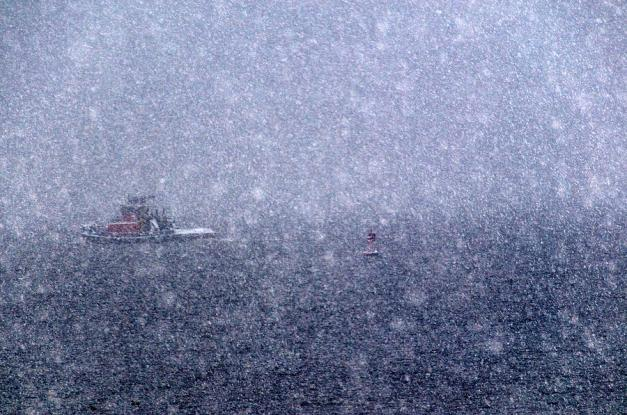a-tugboat-going-out-to-sea-in-a-snow-todd-gipstein